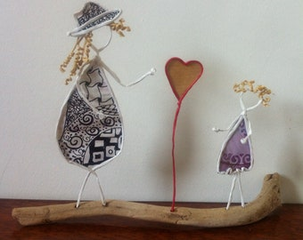 sculptures made of paper, wire reinforced kraft and Driftwood - gift-love-love-child-heart - paper wire gift