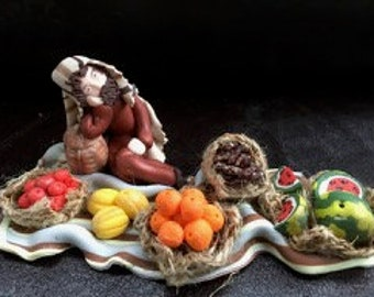 Merchant of fruits and vegetables with polymer clay Christmas crib