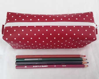 Red pencil case with white polka dots