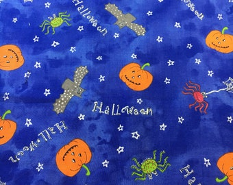 Pumpkins, bats and spiders on blue. Made exclusively for Joann fabrics. Halloween fabric. Sold by the half yard.