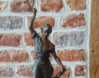 Blacksmith in spelter statue