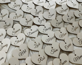 Personalized wooden heart place cards wedding favors. Wedding name tags place cards.