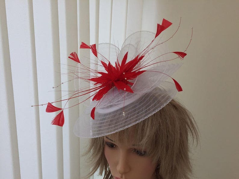 4e897903 White & bright red crin and feather hatinator weddings | Etsy