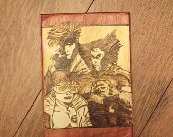 X-Men inspired Wolverine, Gambit, and Jubilee hand-crafted wood burned wall art.