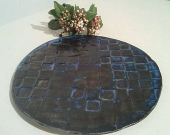 Blue ceramic trivet with tile pattern