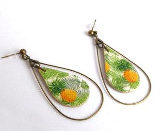 These earrings. Teardrop hoops. Pineapple motif