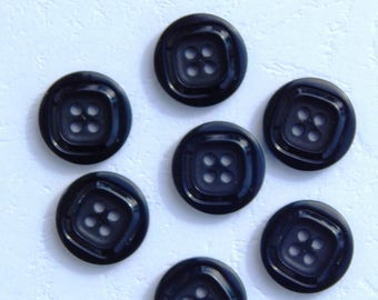 2 black fancy buttons