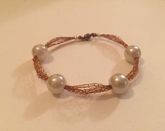 Wire crocheted copper bracelet with large pearl beads