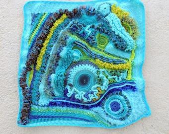 Free-form crochet wall hanging