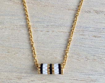 Necklace short white, black and gold tube