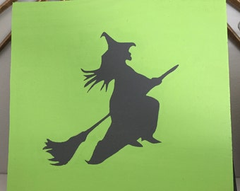Flying witch on a broom wooden sign