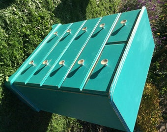Blue chest of drawers with glass knobs