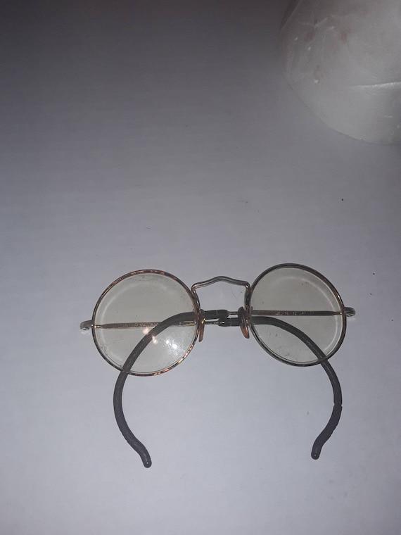 John lennon-style Instant Karma glasses