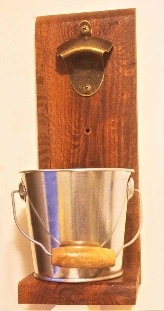 Bottle opener with catching bucket.  Woody Pear