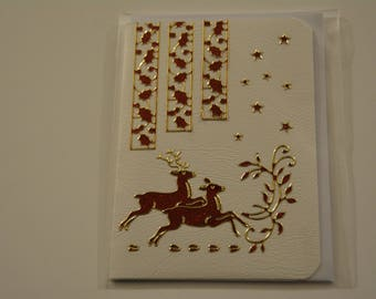 Christmas card with 2 reindeer, scrollwork borders of Holly on white background