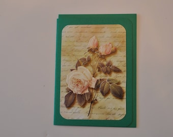 Green card with pale pink roses bouquet