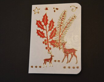 Christmas card with 2 reindeer and Christmas mistletoe and pine branch