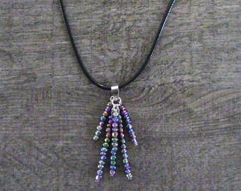 Necklace, pendant of colorful beads, leather cord