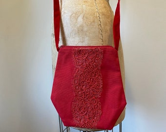 Red purse with lace accent
