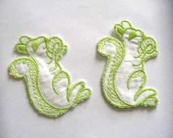 2 appliques sewing squirrels