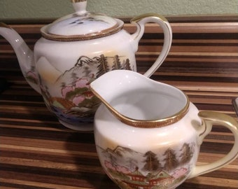 Rare Vintage Hakusan Occupied Japan teapot and saucer. Gold rimmed with beautiful Pagodas and mountain scene