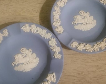 Pair of Matching Wedgwood Blue Jasperware ashtrays with Greek Chariot of the God's Cameo and white grapevine border, 3 cigarette rests