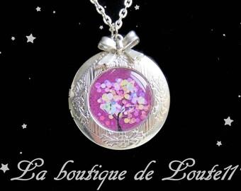 Locket necklace photo tree multicolored ball purple background
