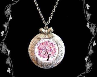 Locket necklace photo tree foliage background Pink White