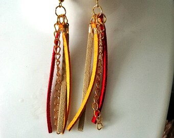 A beautiful dangling earrings made of leather and antique gold chain.