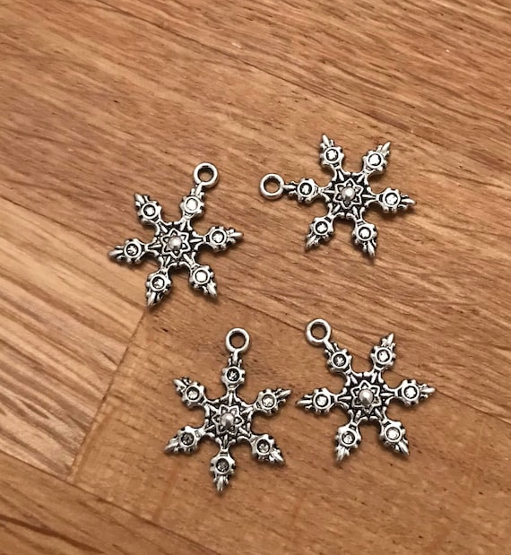 8 Bone charms silver plated tone A819
