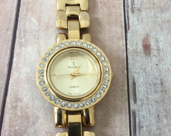 c7b23a053e3 Beautiful Vintage Ladies Gold Tone Peugeot Rhinestone Watch   Link Band    Round Face   New Battery   Working Well   Quartz Watch