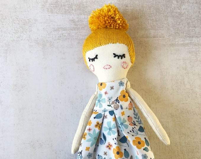 Lila fabric doll with flower dress