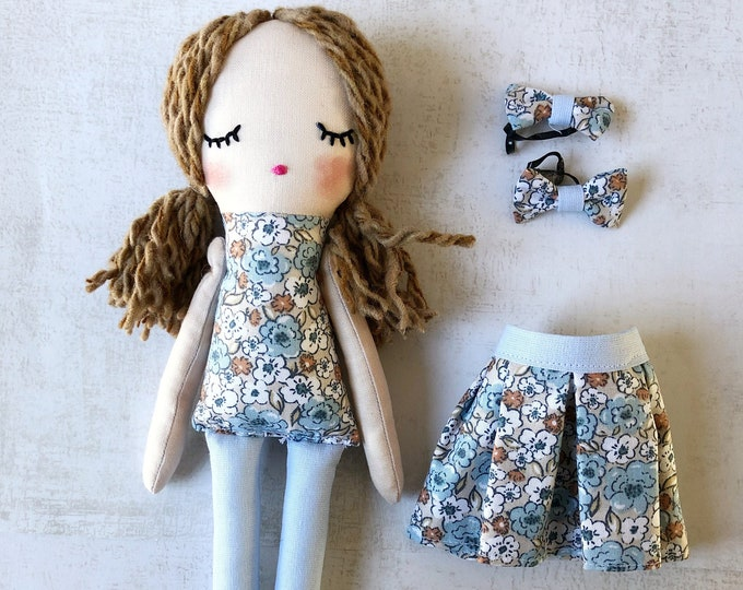 Fabric doll with flower accessories.