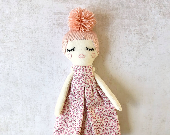 Fabric doll with pompon.
