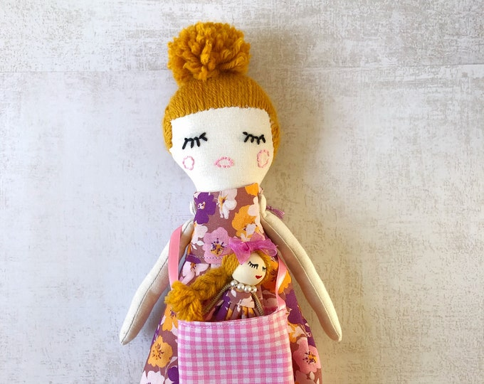 Lila rag doll with toy