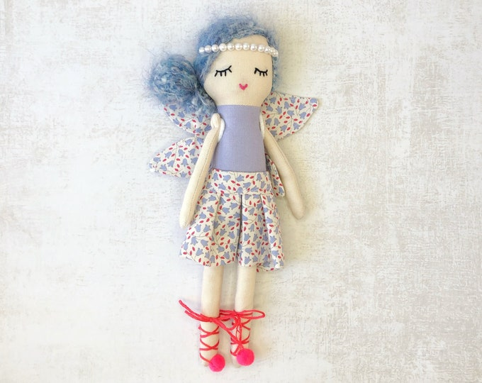 Doll with fairy dress: blue, pink and red.