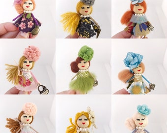 Dolls in promotion, miniature doll brooch