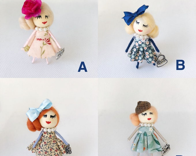 Dolls brooch collection flowers