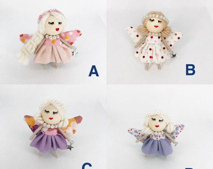 Fairy dolls in brooch format.