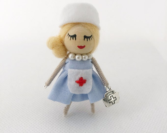 Nurse brooch, nurse doll