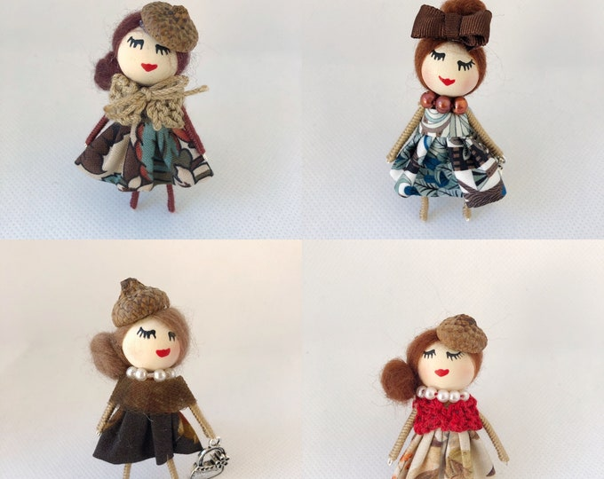 Brown doll brooches
