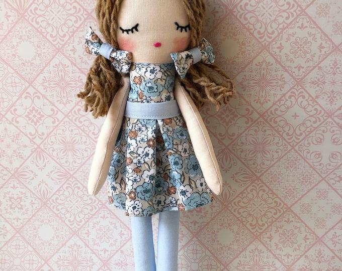 Rag doll with flower skirt