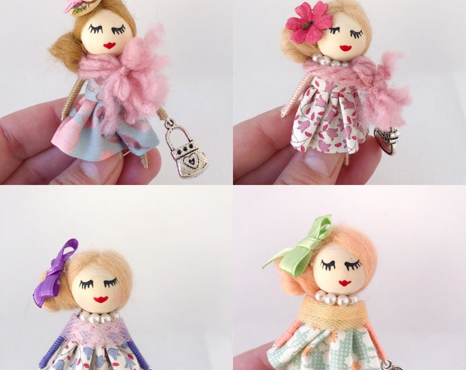 Doll brooches in pastel colors