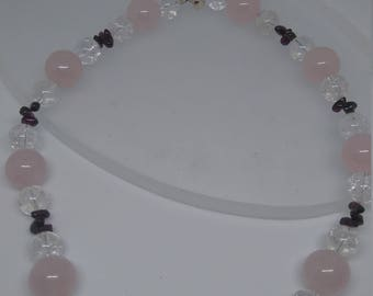 Rose quartz, rock crystal and garnet, with silver clasp