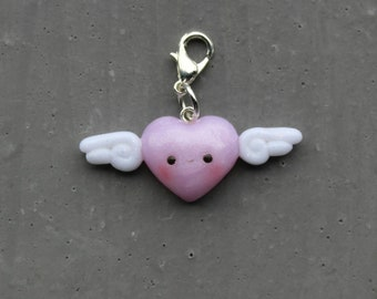 kawaii winged heart charm out of polymer clay