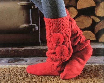 Knitted socks with pompoms