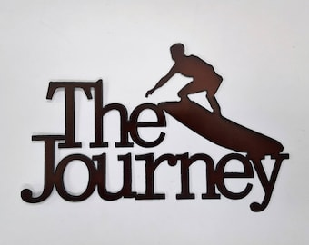 Surfer sign that says The Journey made out of rusted metal