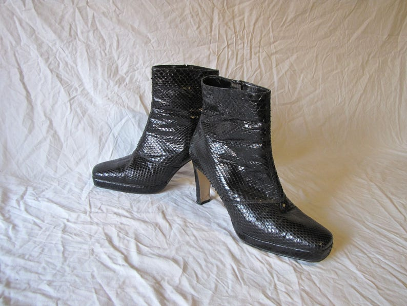 5379c1742 Women s boots in genuine Python leather black ankle boots