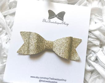 Fine Glitter Bows    Fine Glitter Bow Headbands    Glitter Bow Headbands    Glitter Bow Clips    Baby Headbands & Clips