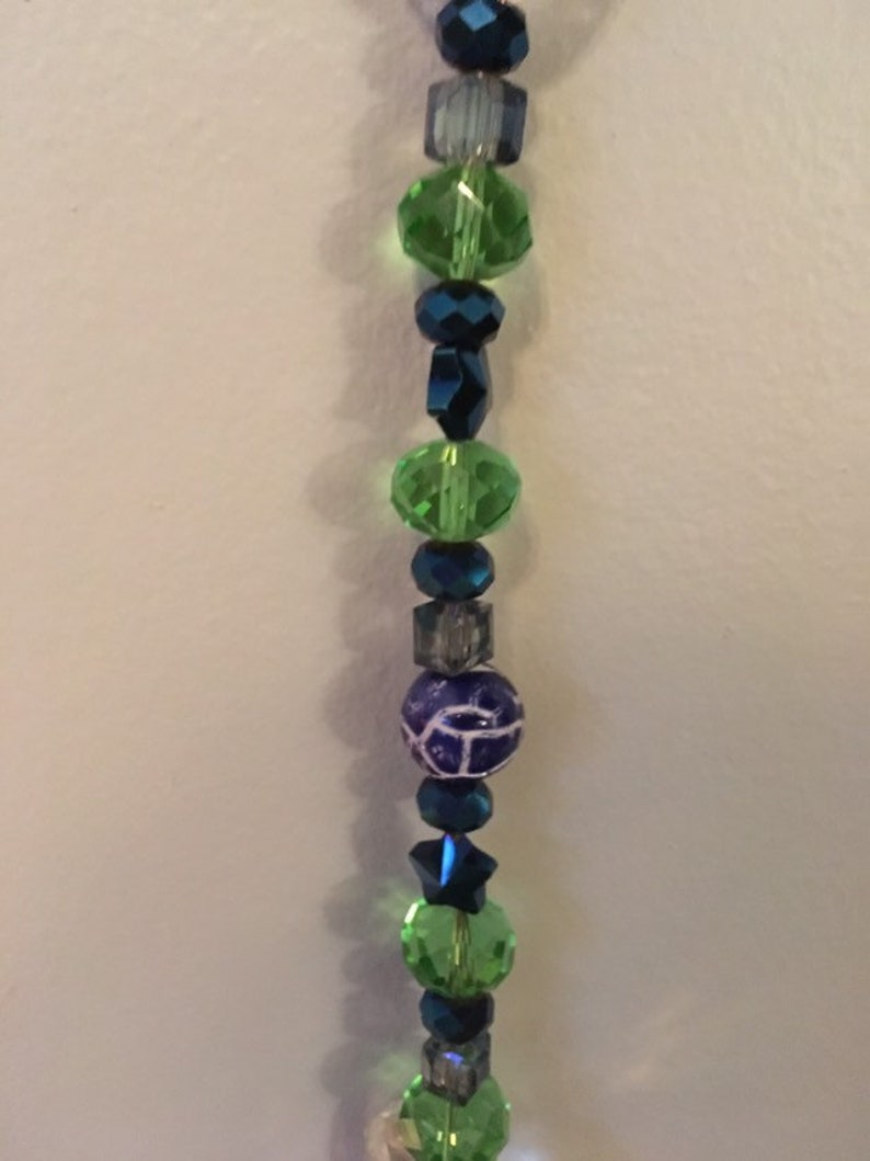 green and clear crystals Lovely crystal suncather Great gift for anytime. Blue